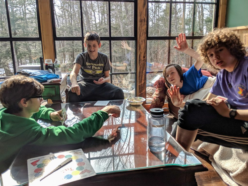 Scouts playing a board game in the cabin